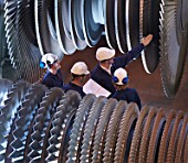 Group Of Engineers With Turbines