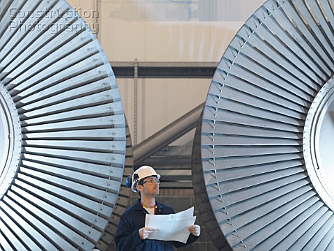 Engineer In Front Of Turbines