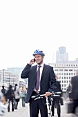 Business man with bicycle & mobile phone