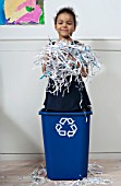 girl in recycling bin
