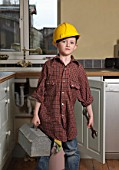 Boy dressed as repair man