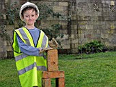Boy dressed as builder