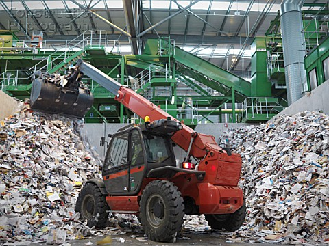 Digger Sorting Recycled Paper
