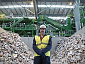 Worker With Paper Being Recycled