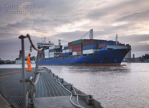 Port Worker And Ship Coming Into Port