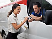 woman signing for delivery from driver
