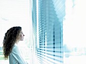 Business woman looking through window
