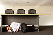 Businessman Sleeping Under Desk