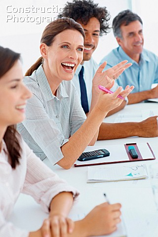 Happy colleagues in a boardroom meeting