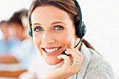 Closeup of call centre employee at work