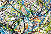 A tangle of colored wires on the ground