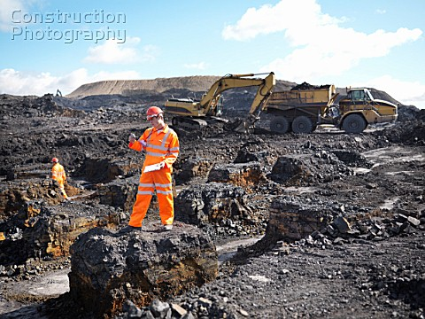 Worker Surveying Coal Mine