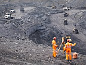 Coal Miners Surveying Mine From Above