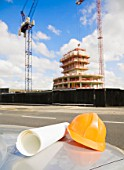 Safety hat & Plans Outside Building Site