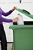 Woman Recycling Plastic Container