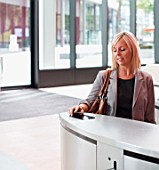 Businesswoman Using Pass to Enter Office