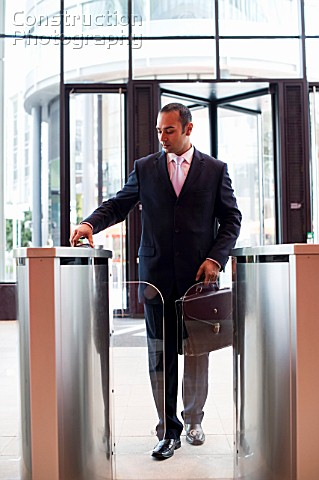 Businessman Using Pass to Enter Office