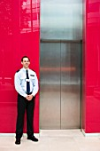 Security Guard Standing by Elevator