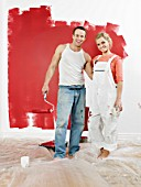 Couple in front of newly painted wall