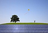 man jumping at solar power panels