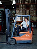 A warehouse manager takes a tea break