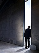 Businessman Standing in Doorway