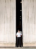 Security Guard Standing by Doors