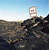 No Parking sign among rocks