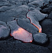 Cooling lava flow on rocks