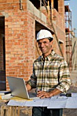 Engineer on building site with computer