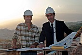 Architect and engineer on building site