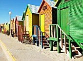 Row of beach huts in bright colours