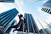 Businessman Jumping in Air in City