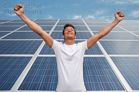 Man standing in front of solar panel