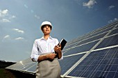 business woman in front of solar panel