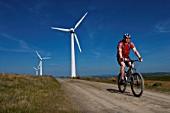 Mountain biker at a wind farm.