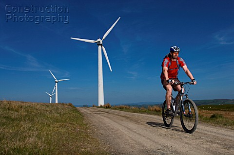 Mountain biker at a wind farm
