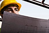 Construction worker holding drawings