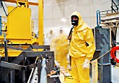 Man in radiation suit in nuclear reactor