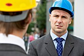 Construction manager talking to a colleague