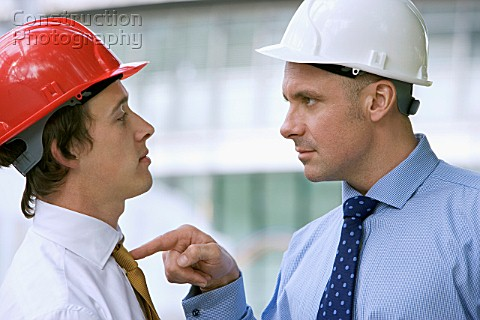 Construction managers arguing on site