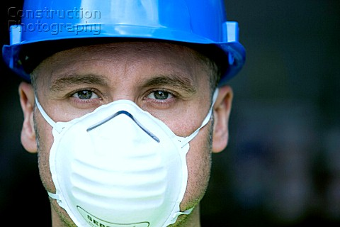 Portrait of a builder with hard hat and mask
