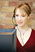 Woman using telephone headset.