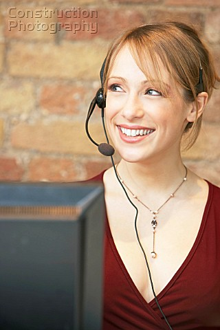 Caucasian woman using telephone headset