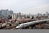CRH 2 class electric multiple unit passing through central Zhengzhou, Henan province, on its way to Xian in Shaanxi province, on the recently opened High Speed line. 26th February 2010.