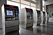 Automatic ticket machines at Zhengzhous new railway station building for High Speed trains, Henan province, China. 27th February 2010.