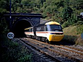An InterCity 125 High Speed Train in British Rail livery emerges from Amptill tunnel South of Bedford with a London St Pancras bound service from the Midlands in August 1990.