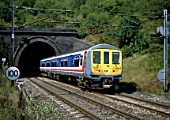 South of Bedford the Midland Main Line is electrified enabling electric multiple unit working through to Brighton via Thames link. Here a Thameslink class 319 emerges from Amptill Tunnel south of Bedford in August 1990.