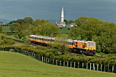 A CIE class 201 diesel electric heads westwrds past the White Abbey at Kildare on Sunday 25th May 2003.