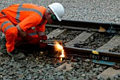 Cutting old rail at Bourne End on Sunday 24th August 2003 as part of the West Coast Main Line upgrade.